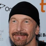 U2 guitarist The Edge, whose given name is David Evans, attends the opening night gala screening of 'From The Sky Down' at Roy Thompson Hall during the Toronto International Film Festival in Toronto. The California Coastal Commission staff has agreed to allow Evans to build a scaled-down compound in the mountains above Malibu. The staff recommended Friday that the commission approve a smaller development than the one originally envisioned.
