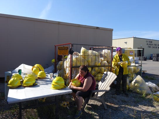Workers at the Alaska Fire Service equipment cache