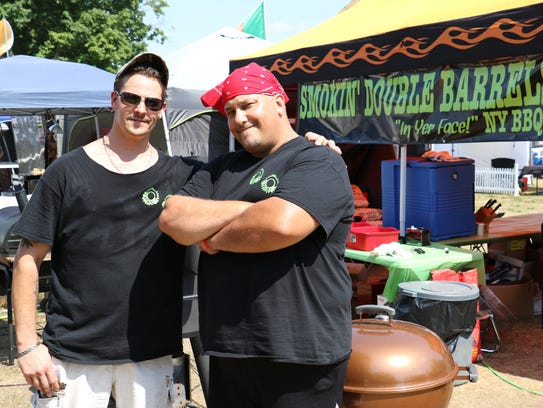Smokin' Double Barrels barbecue team, from left, Nick