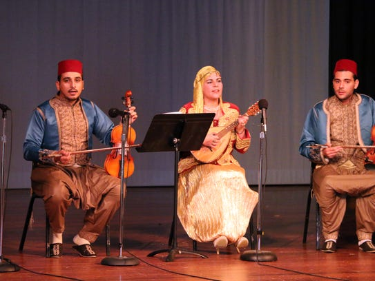 Members of a sextet from Mascara, Algeria, perform