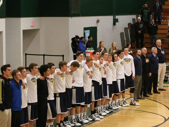 The Hartland boys hoops team came together at the end