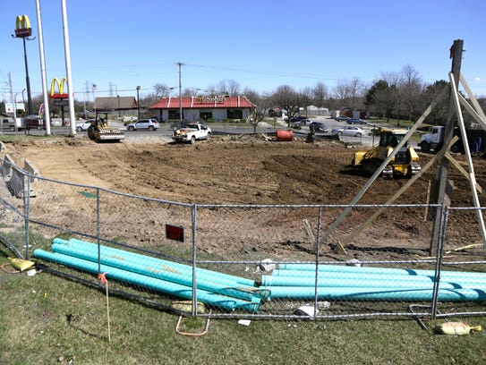 Construction crews work on the future location of the