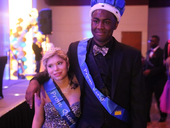Prom queen Peyton Smith and prom king Nick Fuches pose