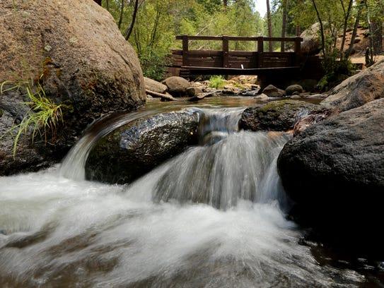 The Santa Clara River flows under a bridge in the Pine
