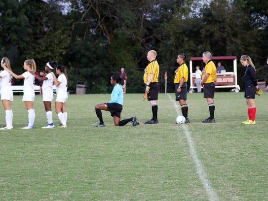 Brebeuf Jesuit goalkeeper Lauren Turner kneels during