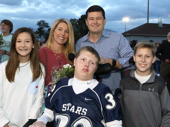 Baylor Bramble and his family at Siegel's senior night,