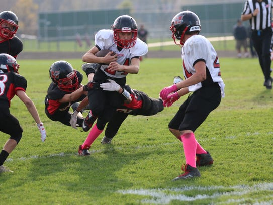 Muskego Red battles Muskego Black in the AAYFL South