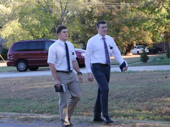 Elder Ty Hinds, left, and Elder Cameron McDonald, right,
