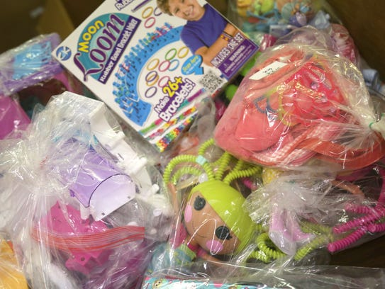 Used toys are cleaned and packaged before the annual