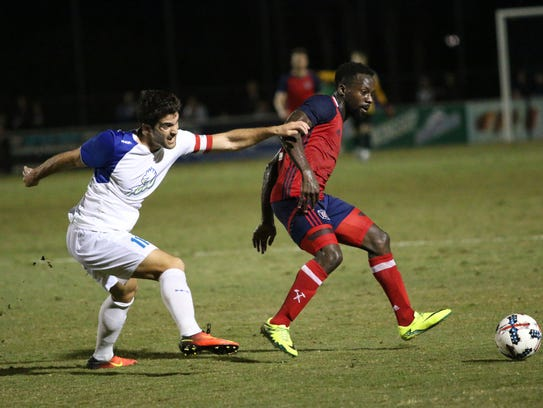 Albert Ruiz, left, and David Accam fight for possession
