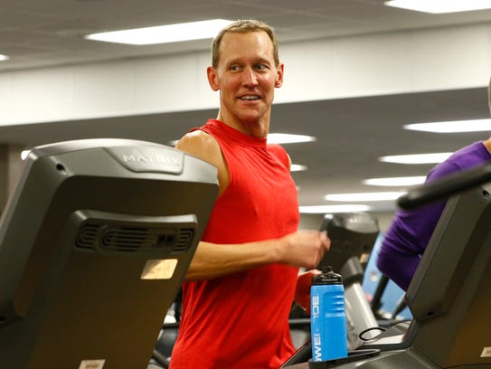 Chad Esker, of Mosinee, runs on a treadmill during