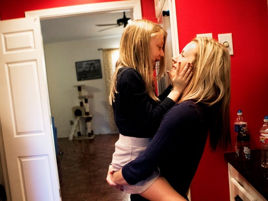 Anna Varnado holds her 9-year-old daughter Marin Varnado