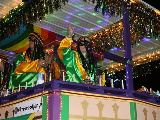 The Krewe of Janus Mardi Gras parade rolls along Louisville