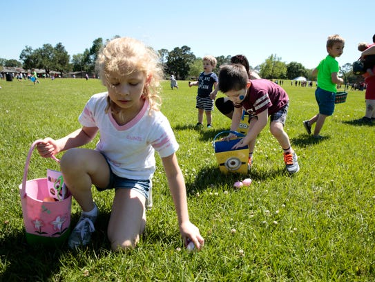 Children hunt for eggs during an Easter egg hunt in 2017.