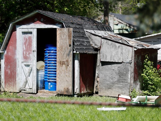 A shed stands in a backyard where police say a man