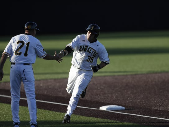 Jake Adams rounds third base after homering in Iowa's