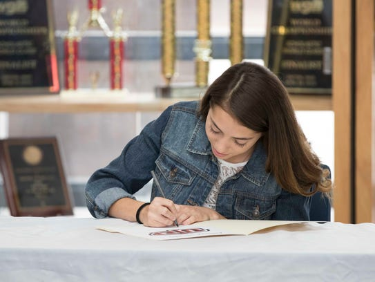 Americas' Andrea Lucero signs her National Letter of