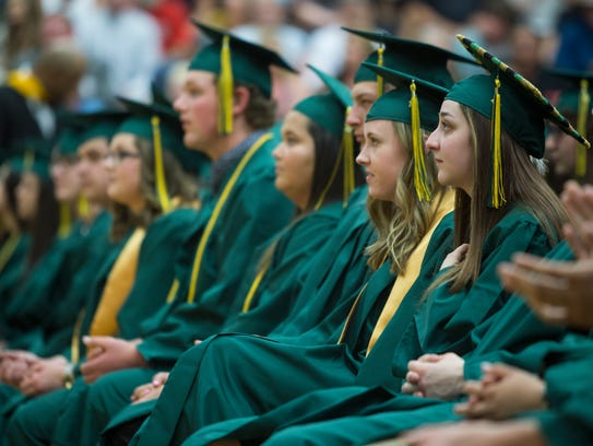 Three hundred eighteen Charles M. Russell seniors receive diplomas in the CMR Field House.