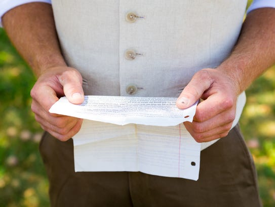 A groom practices reading his vows before the wedding