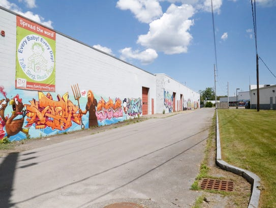 Graffiti, murals and wall art span the outer walls