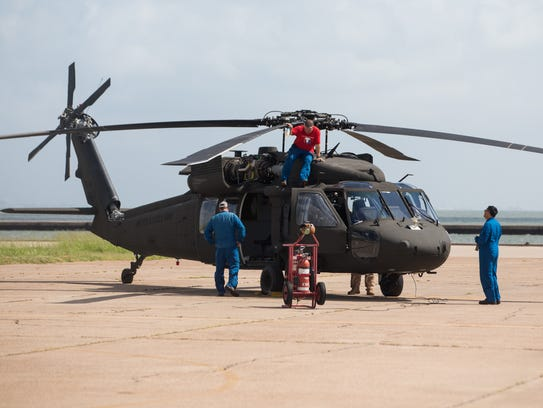 An Army UH-60L Blackhawk sits on the tarmac at Corpus