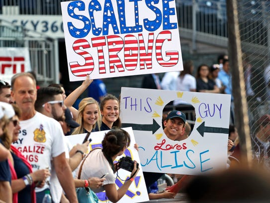 Supporters of Rep. Steve Scalise, R-La., hold signs