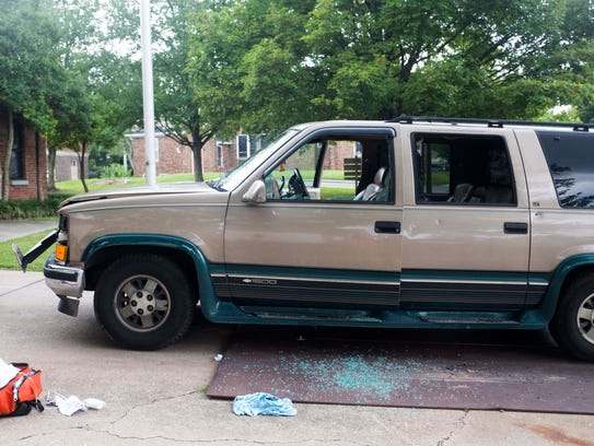 The front and driver's-side windows of an SUV were