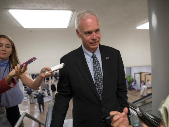 Sen. Ron Johnson (R-Johnson) heads to the chamber for