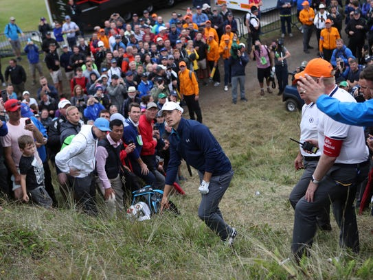 Jordan Spieth of the United States in the rough on