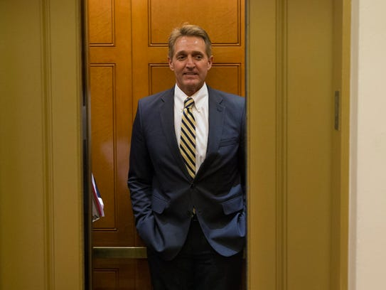 Sen. Jeff Flake stands in an elevator on his way to