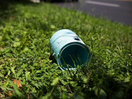 An empty paint can lays on the grass near a confederate