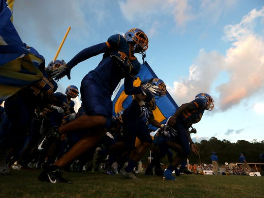 Rickards' players charge out on to the field to play