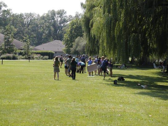 Crowds gather at Stewart Park to watch the solar eclipse