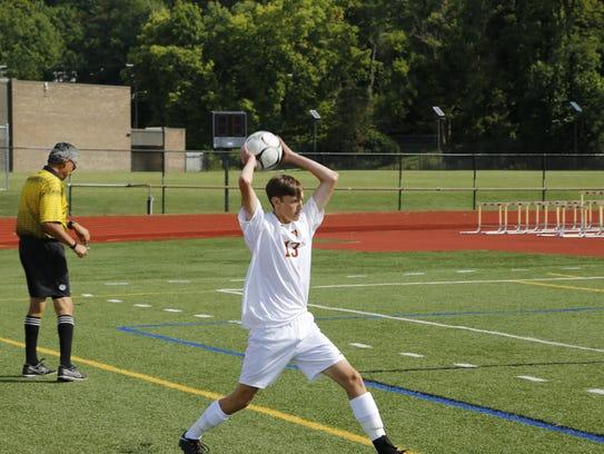 Ithaca's Satya Maitreya throws the ball in against