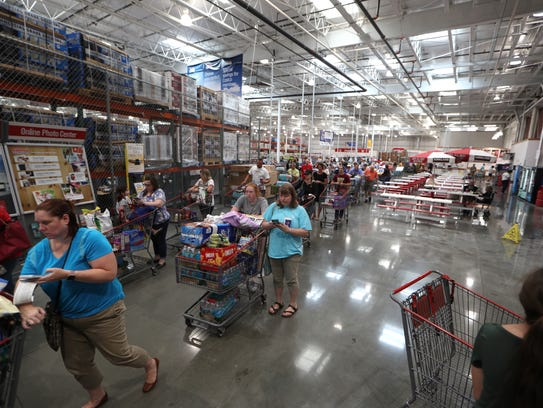 Shoppers fill the checkout lines at Costco, in preparation