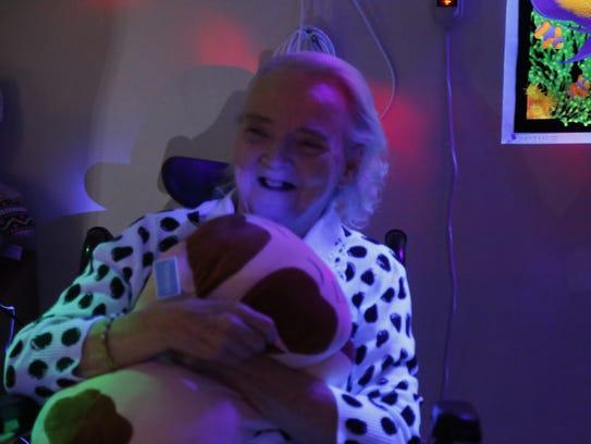 Rosalee Devlen hugs a plush cat doll.