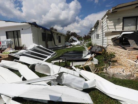 A heavily damaged home in Oak Park in Alva, Florida.