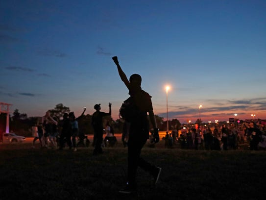 Protesters march, Friday, Sept. 15, 2017, in St. Louis,
