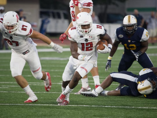 Austin Peay running back Tre Nation carries the ball