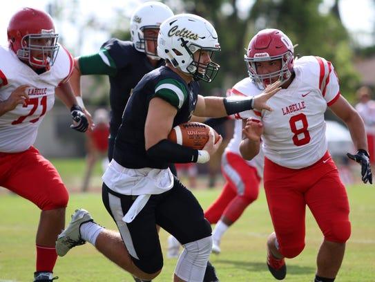 St. John Neumann quarterback Jensen Jones carries the