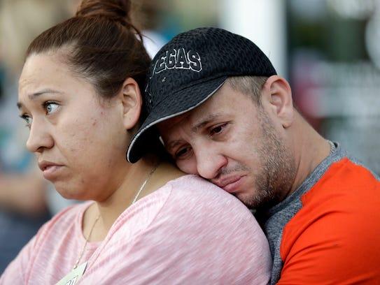 Rosa and Alan Duarte become emotional during a vigil