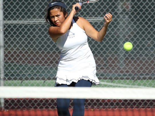 Maddie Nguyen of O'Gorman hits a return in her match