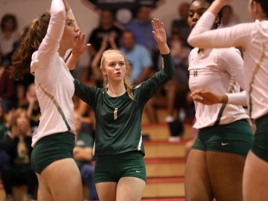 Lincoln's Daelynn Shoaf celebrates a point with her