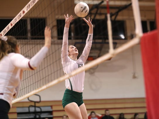 Lincoln's Loren Scott sets the ball against Chiles