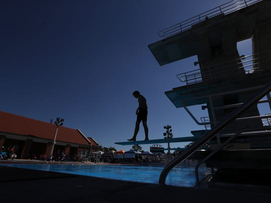 Divers compete during the Region 1-3A swimming and