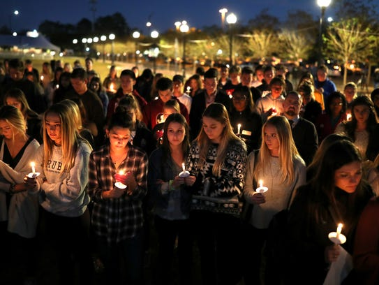 Hundreds gather for a vigil in memory of Andrew Coffey,