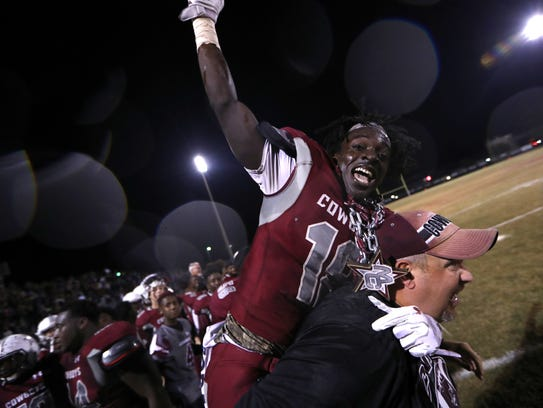Madison's Travis Jay celebrates on the sidelines as