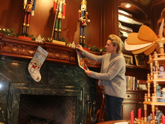 Tanya Schneider puts the finishing touches on decorations