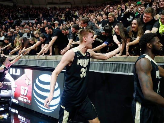 Purdue Boilermakers forward Matt Haarms (32) high fives