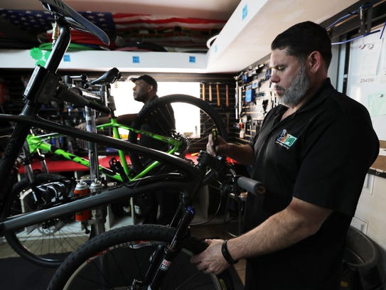 David Williams, right, and Arley Miche, co-own Just Riding Around (JRA), a bicycle sales and service shop in North Fort Myers.